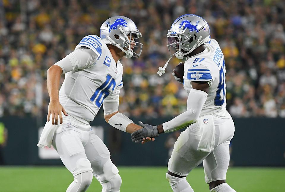 Lions wide receiver Quintez Cephus, right, celebrates a touchdown with quarterback Jared Goff during the first half on Monday, Sept. 20, 2021, in Green Bay, Wisconsin.