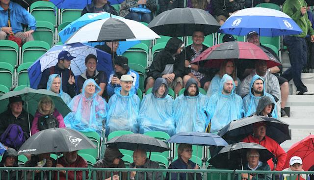 HOYLAKE, ENGLAND - JULY 19: Golf fans endure the elements during the third round of The 143rd Open Championship at Royal Liverpool on July 19, 2014 in Hoylake, England. (Photo by Andrew Redington/Getty Images)
