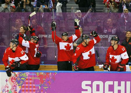Canada's bench celebrates during their men's semi-final ice hockey victory over Team USA at the 2014 Sochi Winter Olympic Games, February 21, 2014. REUTERS/Gary Hershorn