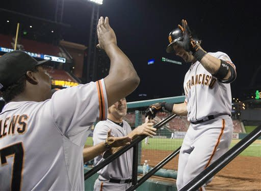 San Francisco Giants' Marco Scutaro, right, high-fives Hensley Meulens after hitting a grand slam during the ninth inning of a baseball game against the St. Louis Cardinals Wednesday, Aug. 8, 2012, in St. Louis. The Giants won 15-0. (AP Photo/Jeff Curry)