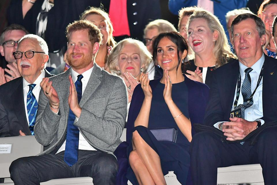 The Duke and Duchess of Sussex enjoying the Invictus Games opening ceremony at Sydney's Opera House. Photo: Getty