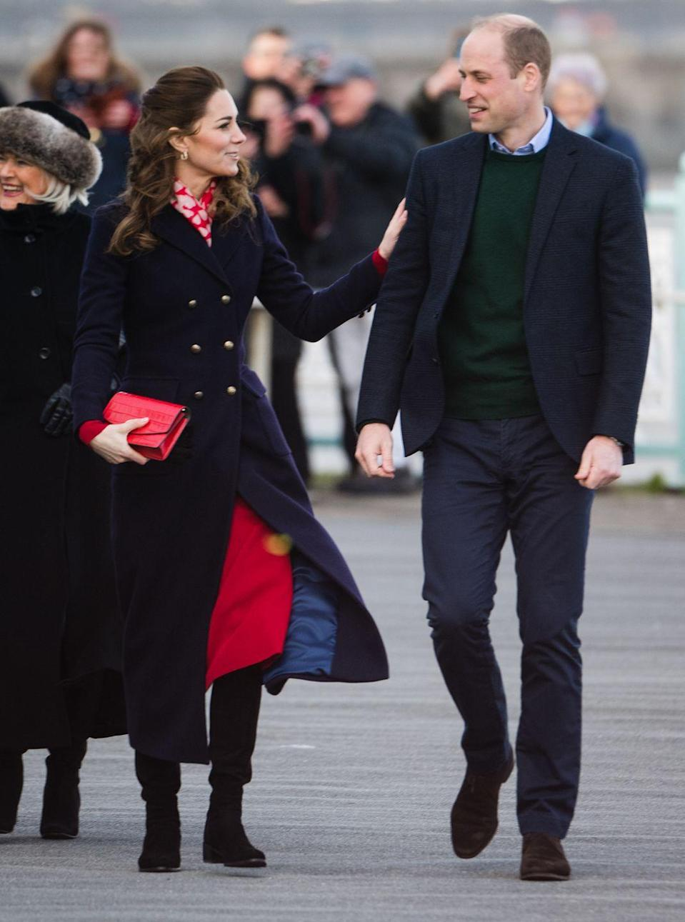 <p>The Duchess of Cambridge put a loving hand on her husband's arm during their visit to Mumbles Pier on February 4, 2020 in Swansea, Wales.</p>