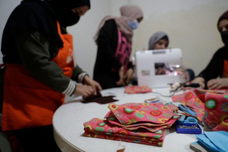 Members of international NGO Days For Girls and local partner WingWoman Lebanon assemble reusable sanitary kits in the Palestinian refugee camp of Shatila (AFP/Getty)