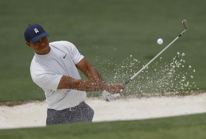 Tiger Woods hits from a bunker on the second hole during the second round for the Masters golf tournament Friday, April 12, 2019, in Augusta, Ga. (AP Photo/Matt Slocum)