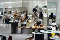 Shoppers browse a shoe department at the Nordstrom NYC Flagship store, in New York, Wednesday, July 14, 2021. Like many of its peers, venerable department store chain Nordstrom is having a tough time keeping pace with customer demand for new clothes because of supply issues. (AP Photo/Richard Drew)