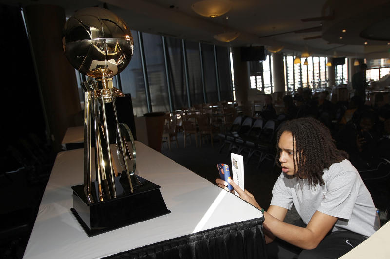 Baylor center Brittney Griner photographs The Associated Press  women's college basketball player of the year trophy before an awards ceremony before the NCAA Women's Final Four basketball tournament in Denver, Saturday, March 31, 2012. (AP Photo/David Zalubowski)