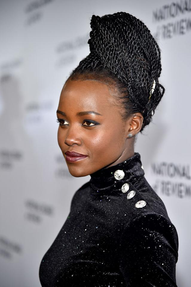<p>At the National Board Of Review's annual awards ceremony, Nyong'o rocked a beautiful braided updo. (Photo: Getty Images) </p>