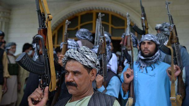 PHOTO: Afghan militia gather with their weapons to support Afghanistan security forces against the Taliban, in Afghan warlord and former Mujahideen Ismail Khan's house in Herat on July 9, 2021.  (Hoshang Hashimi/AFP via Getty Images)