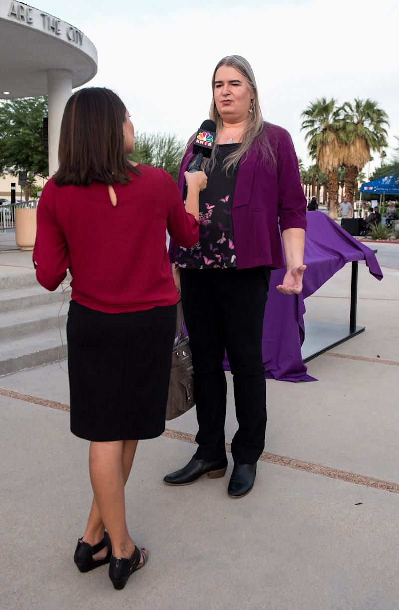 Gwendolyn Ann Smith is interviewed prior to a candlelight vigil at the Palm Springs City Hall as the Transgender Community Coalition honors the memory of those whose lives were lost in acts of anti-transgender violence in 2017.