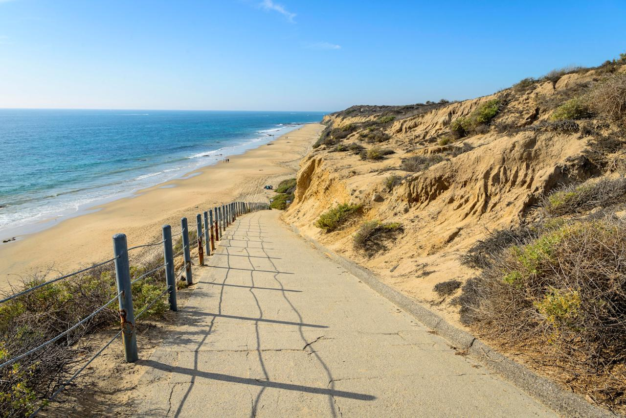 "<p><strong>Why we love it:</strong> Crystal Cove State Park has four of the best beaches in California spread along 3.2 miles of rugged coastline, complete with tidepools, easy hiking trails, and campsites. Head to Moro Beach for water sports like surfing and paddle-boarding (just remember to bring your own gear), or take the kids to explore at Pelican Point and Little Treasure Cove. Keep an eye out for the Historic District, where you'll find rustic beachfront cottages from the 1930s and '40s (you can even <a href=""https://crystalcove.org/beach-cottages/"">rent one for the night</a> if you book well in advance).</p> <p><strong>How to get there:</strong> The park is located off Pacific Coast Highway between Corona del Mar and Laguna Beach, about an hour south of Los Angeles. All four entrance points are easy to access from the 405 and 5 freeways.</p> <p><strong>Other things to do:</strong> Just up the hill from the park's northern end is <a href=""https://www.cntraveler.com/hotels/united-states/newport-coast/resort-at-pelican-hill-newport-coast?mbid=synd_yahoo_rss"">The Resort at Pelican Hill</a>, a Mediterranean-inspired retreat with luxury villas and a fabulous swimming pool. Use the resort as your home base, or just pop in for a spa treatment and dinner. For something decidedly more casual, check out <a href=""http://www.ocfunzone.com/"">Balboa Fun Zone</a>, a harbor-side amusement park 20 minutes away on Balboa Island.</p>"