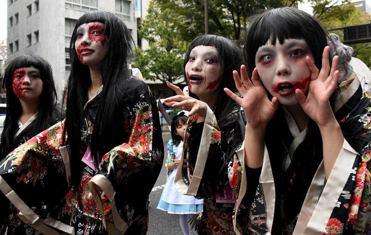 Participants in Kawasaki Halloween Parade show off their gory makeup