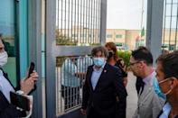 Ex-Catalan president Carles Puigdemont walks out of jail in the Sardinian town of Sassari to cheers from supporters (AFP/Gianni BIDDAU)