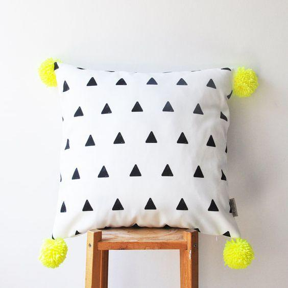 "<p>Brigthen up your cushions by simple adding a few colourful pom poms. It's easy. <i><a href=""https://uk.pinterest.com/pin/97249673182342336/""> [Photo: Pinterest]</a></i></p>"