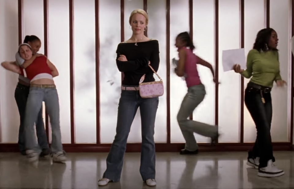 <p>The limit of amazing outfits in <em>Mean Girls</em> does not exist (get it?). One of the best, however, is Rachel McAdams dressed in flared jeans, gleefully watching the halls of North Shore High spiral into chaos. </p>