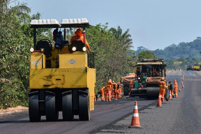 Workers pave the BR163 highway in Itaituba -- President Jair Bolsonaro's government is eager to develop the Amazon to bolster Brazil's weak economy