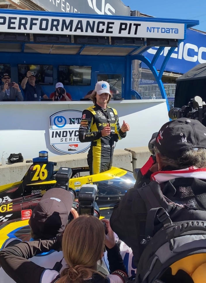 Colton Herta poses after winning the pole, Saturday, Sept. 18, 2021, at Laguna Seca Raceway in Monterey, Calif. Herta is the defending race winner from 2019. (AP Photo/Jenna Fryer)