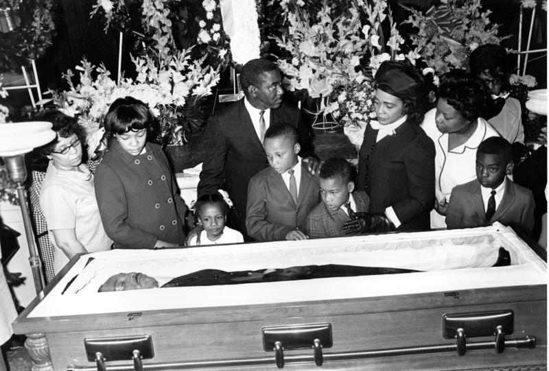Coretta Scott King, and her four children view the body of her husband, slain civil rights activist leader Dr. Martin Luther King Jr., in Atlanta, Ga., on April 7, 1968.  The children are, from left, Yolanda, 12, Bernice, 5, Martin III, 11, and Dexter 7.  The civil rights leader was standing on the balcony of the Lorraine Motel when he was killed by a rifle bullet on April 4, 1968. James Earl Ray pleaded guilty to the killing and was sentenced to 99 years in prison. He died in prison in 1998. (AP Photo)