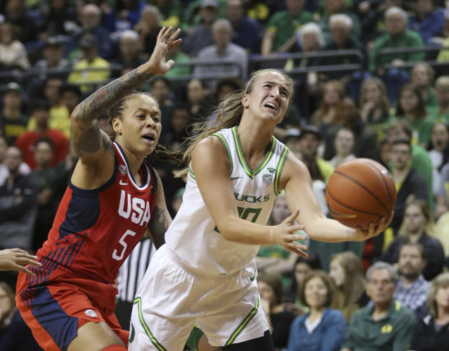 "Oregon's Sabrina Ionescu, right, goes up for a shot ahead of United States' <a class=""link rapid-noclick-resp"" href=""/wnba/players/4059/"" data-ylk=""slk:Seimone Augustus"">Seimone Augustus</a>, left, during the second quarter of an exhibition basketball game in Eugene on Saturday. (AP/Chris Pietsch)"