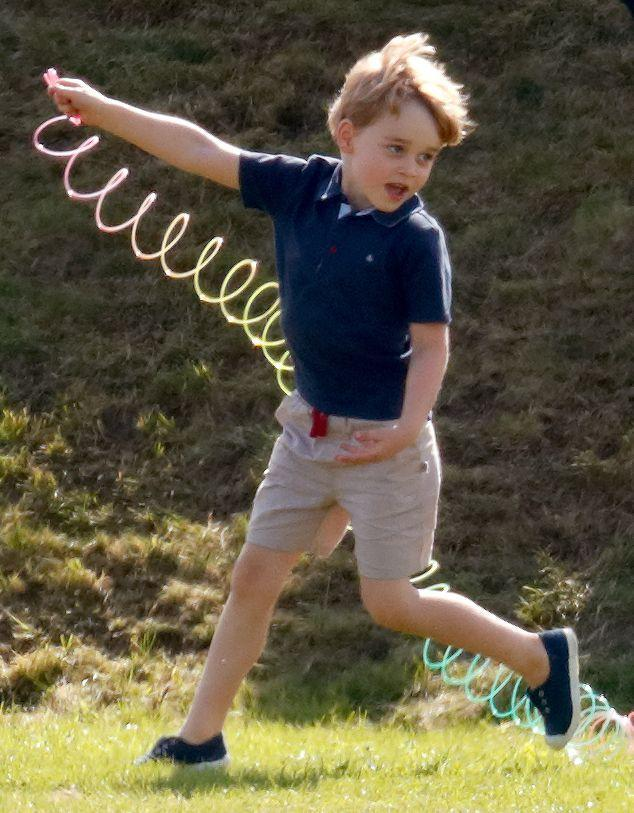 """<p>Prince George <a href=""""https://www.townandcountrymag.com/society/tradition/g21252656/prince-george-princess-charlotte-polo-match-photos/"""" rel=""""nofollow noopener"""" target=""""_blank"""" data-ylk=""""slk:had a blast playing with his sister"""" class=""""link rapid-noclick-resp"""">had a blast playing with his sister</a> and cousins on the sidelines of the polo match.</p>"""