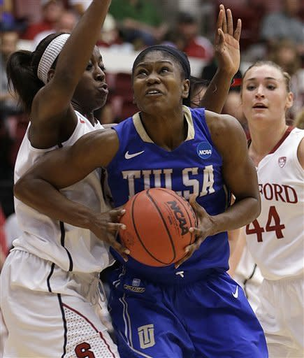 Tulsa's Tiffani Couisnard, center, looks to shoot against Stanford's Chiney Ogwumike, left, and Joslyn Tinkle (44) during the first half of a first-round game in the women's NCAA college basketball tournament on Sunday, March 24, 2013, in Stanford, Calif. (AP Photo/Ben Margot)
