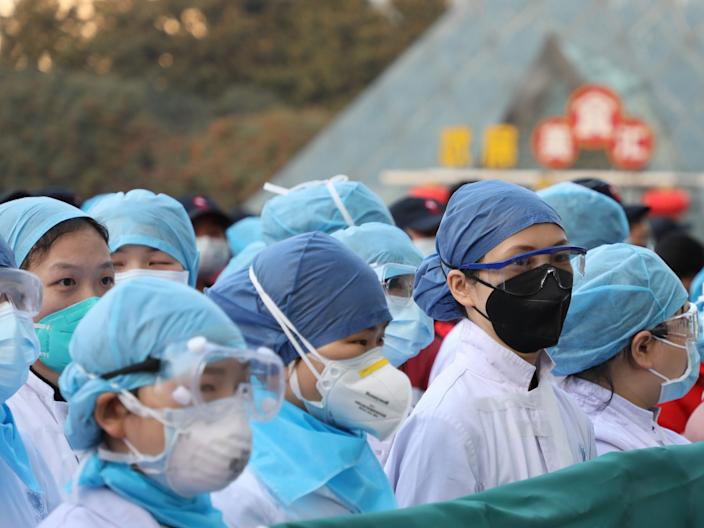 Medical staff members who took over a large temporary hospital built in an exhibition center in Wuhan.
