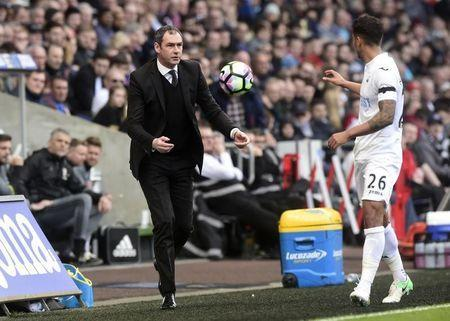 Britain Football Soccer - Swansea City v Middlesbrough - Premier League - Liberty Stadium - 2/4/17 Swansea City manager Paul Clement throws the ball to Kyle Naughton Reuters / Rebecca Naden Livepic
