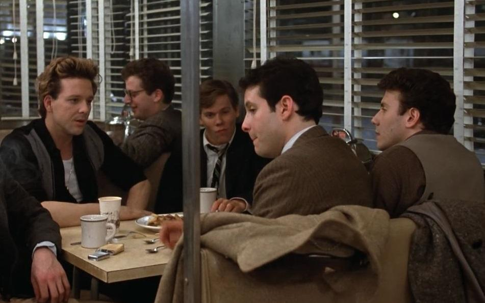 <p>Bacon (pictured centre, almost obscured by a post) gave the first clear indications of his range in this early Brat Pack-era drama from director Barry Levinson, notable for its cast of future stars including Mickey Rourke, Daniel Stern, Steve Gutenberg and Paul Reiser. (Picture credit: MGM-UA) </p>
