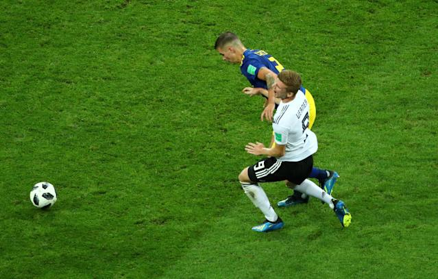 Soccer Football - World Cup - Group F - Germany vs Sweden - Fisht Stadium, Sochi, Russia - June 23, 2018 Germany's Timo Werner goes down under the challenge of Sweden's Mikael Lustig REUTERS/Hannah McKay