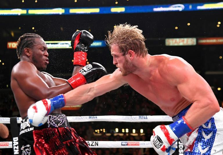 Logan Paul, right, delivers a punch to KSI in their cruiserweight fight Saturday at Los Angeles (AFP Photo/Jayne Kamin-Oncea)