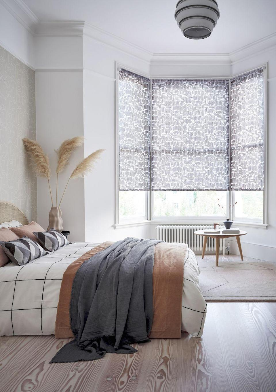"<p>Matchsticks Mono is a stylish illustrative fabric featuring angled geo lines. It would look fantastic in any interior, and it works especially well in a bedroom, as pictured here. It really complements this pared-back Scandi vibe alongside a palette of burnt orange and subtle pinks.</p><p><a class=""link rapid-noclick-resp"" href=""https://www.hillarys.co.uk/products/matchsticks-mono-roller-blind/"" rel=""nofollow noopener"" target=""_blank"" data-ylk=""slk:Order a sample and request an appointment"">Order a sample and request an appointment</a></p>"