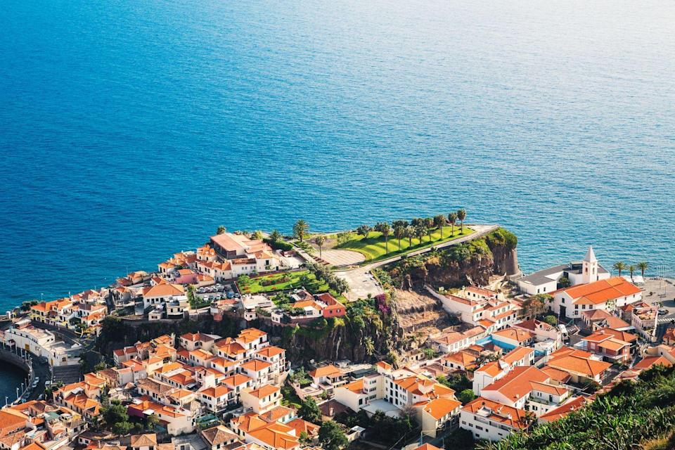 <p>Incredibly lush, the Portuguese island of Madeira feels like a mix between a tropical vacation and a European town. Make sure you swim in the natural swimming pool of Porto Moniz, hike the Vereda dos Balcões up to the lookout point for panoramic views, and see in the Risco waterfall in the island's leafy forest. </p>