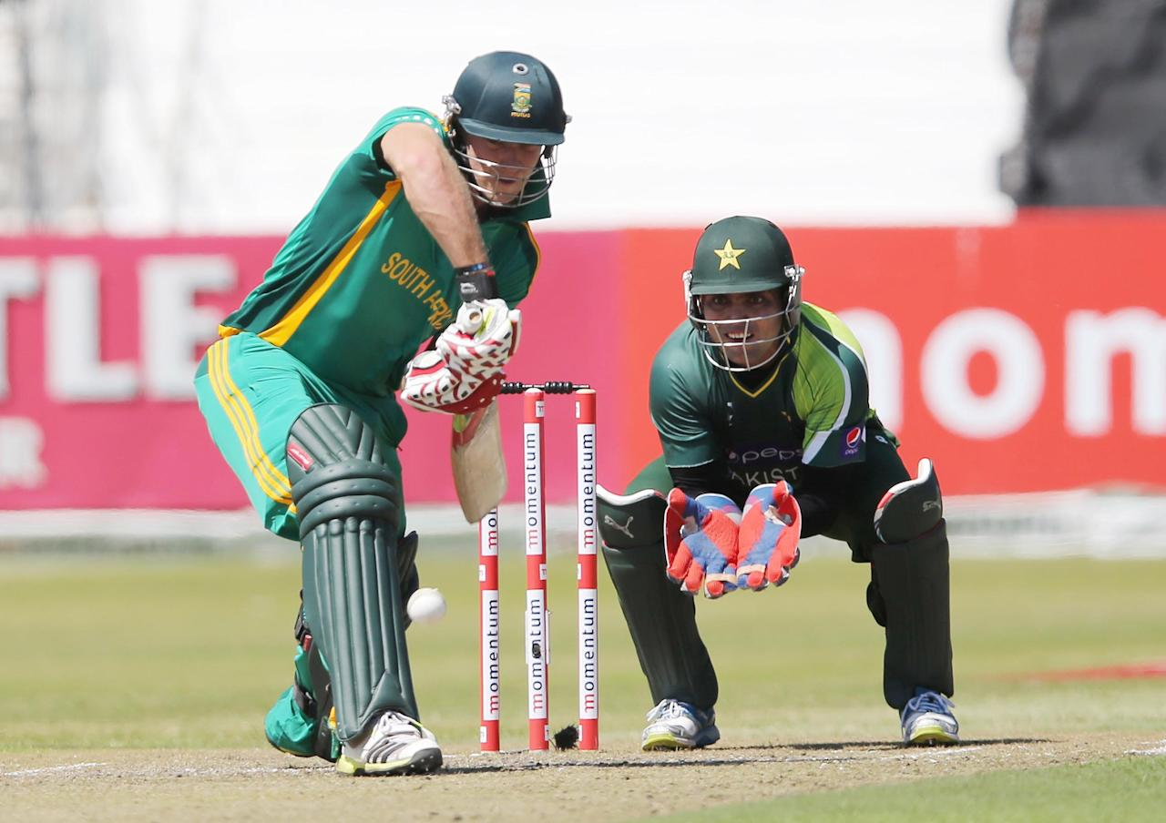 DURBAN, SOUTH AFRICA - MARCH 21:  David Miller of South Africa bats as wicketkeeper Kamran Akmal looks on during the 4th Momentum One Day International match between South Africa and Pakistan at Sahara Stadium Kingsmead on March 21, 2013 in Durban, South Africa.  (Photo by Anesh Debiky/Gallo Images/Getty Images)