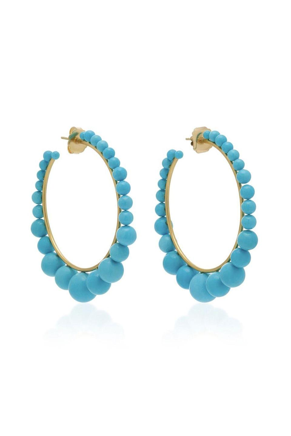"""<p><strong>Irene Neuwirth</strong></p><p>modaoperandi.com</p><p><strong>$10650.00</strong></p><p><a href=""""https://go.redirectingat.com?id=74968X1596630&url=https%3A%2F%2Fwww.modaoperandi.com%2Firene-neuwirth-fw19%2F18k-gold-and-turquoise-hoop-earrings-3&sref=https%3A%2F%2Fwww.townandcountrymag.com%2Fstyle%2Fjewelry-and-watches%2Fg33469392%2Fthe-weekly-covet-july-31-2020%2F"""" rel=""""nofollow noopener"""" target=""""_blank"""" data-ylk=""""slk:Shop Now"""" class=""""link rapid-noclick-resp"""">Shop Now</a></p><p>These hoops by Irene Neuwirth are the perfect pop of color for the summertime. </p>"""