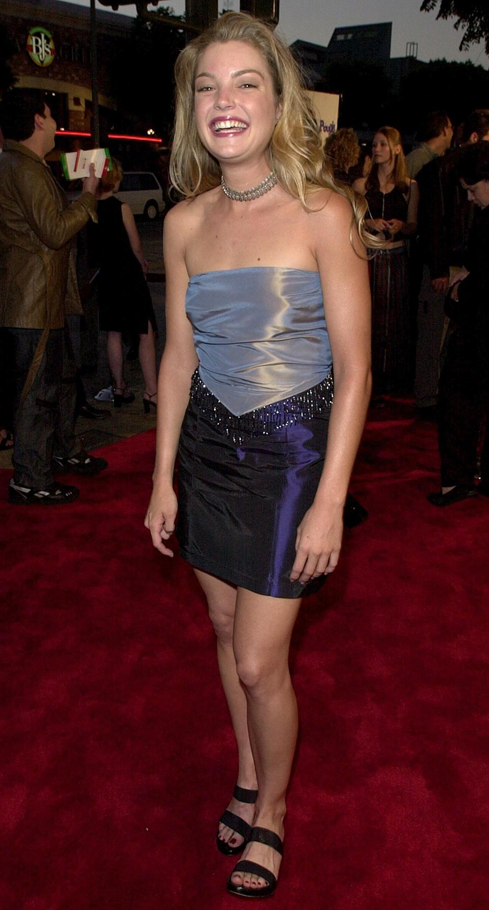 <p>Clare, a fellow Toro, played Courtney in <b>Bring It On</b>, who had a bold personality - just like this red carpet look. Clare's satin, jewel-toned separates came complete with a beaded fringe hem to match her choker, and she wore easy, black strappy sandals.</p>