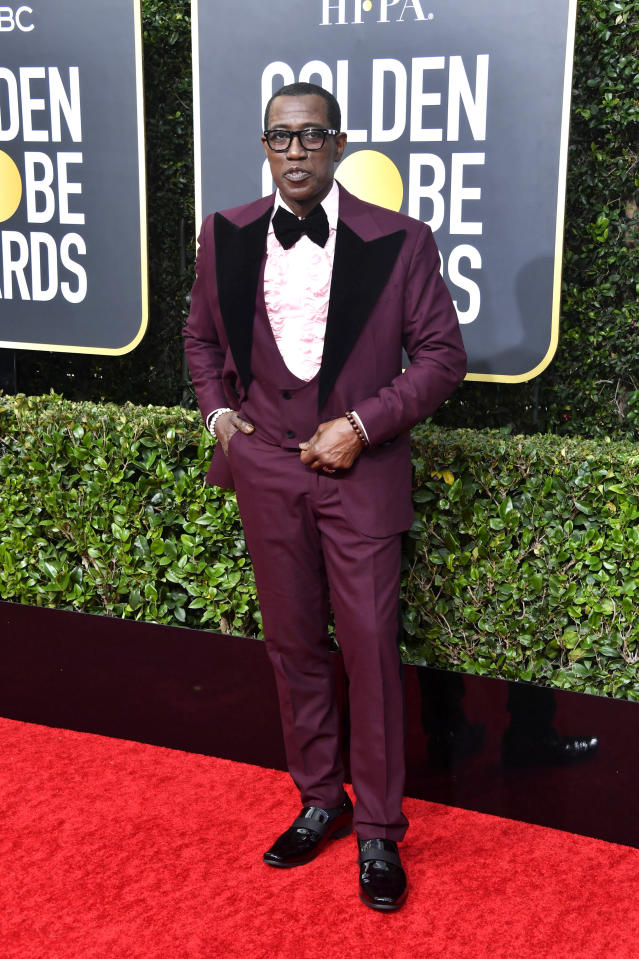 Wearing a maroon suit. <em>[Photo: Getty]</em>