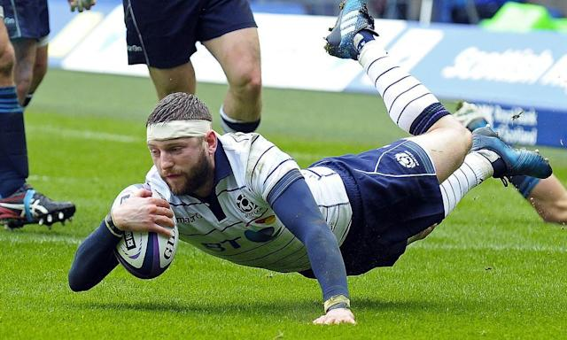 """<span class=""""element-image__caption"""">Finn Russell dives over to score Scotland's first try in their 29-0 Six Nations victory over Italy at Murrayfield.</span> <span class=""""element-image__credit"""">Photograph: Andy Buchanan/AFP/Getty Images</span>"""