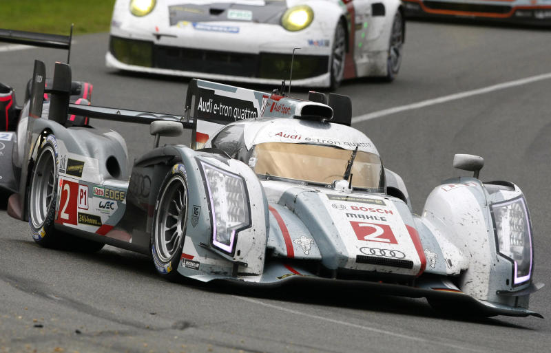 The Audi R18 E-Tron No2 driven by Tom Kristenssen of Denmark, Loic Duval of France and Allan McNish of Scotland in action during the 90th 24-hour Le Mans endurance race, in Le Mans, western France, Sunday, June 23, 2013. (AP Photo/Michel Spingler)