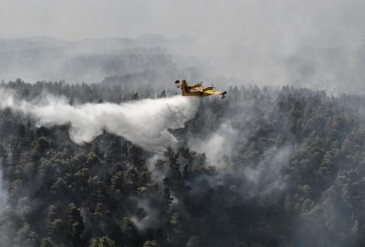 Firefighters managed to contain the fire in a ravine near the village of Platana, backed by nearly 100 vehicles, nine helicopters and nine planes