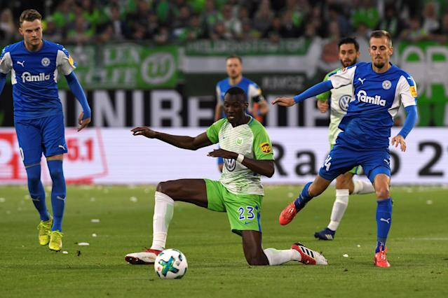 Soccer Football - Bundesliga Promotion/Relegation Playoff First leg - VfL Wolfsburg v Holstein Kiel - Volkswagen Arena, Wolfsburg, Germany - May 17, 2018 Wolfsburg's Josuha Guilavogui in action REUTERS/Fabian Bimmer DFL RULES TO LIMIT THE ONLINE USAGE DURING MATCH TIME TO 15 PICTURES PER GAME. IMAGE SEQUENCES TO SIMULATE VIDEO IS NOT ALLOWED AT ANY TIME. FOR FURTHER QUERIES PLEASE CONTACT DFL DIRECTLY AT + 49 69 650050