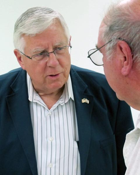 In this July 2, 2013 photo. U.S. Sen. Mike Enzi, R-Wyo., left, talks to constituent John Marquardt at a senior center in Pine Bluffs, Wyo. Enzi announced Tuesday, July 16, 2013, that he will run for re-election to the Senate. Liz Cheney, daughter of former Vice President Dick Cheney, said she will challenge him in the 2014 Republican primary. (AP Photo/Ben Neary)