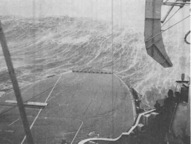A wave crashes over the bow of HMCS Bonaventure on Dec. 6, 1959. Bryce Allen says the deck was 20 metres above the waterline, but it was flooded by wave after wave.
