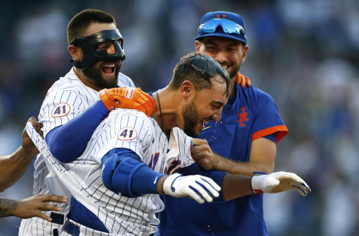 New York Mets Michael Conforto celebrates with teammates after defeating the Philadelphia Phillies in a baseball game Saturday, June 26, 2021, in New York. (AP Photo/Noah K. Murray)