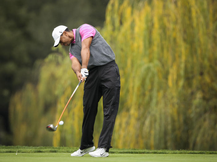 Tiger Woods tees off on the fifth hole during the second round of the World Challenge golf tournament at Sherwood Country Club in Thousand Oaks, Calif., Friday, Nov. 30, 2012. (AP Photo/Bret Hartman)