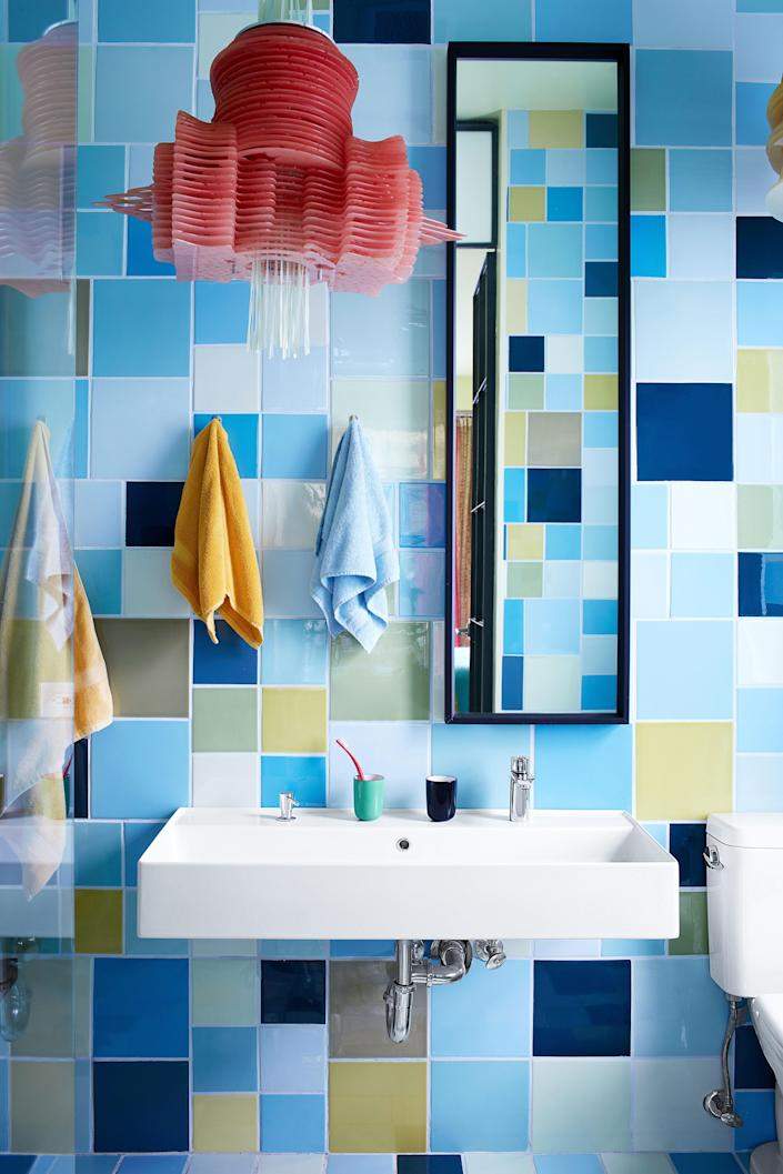 "For the primary bath, as throughout the house, tiles of Pardo's own imagination were produced at <a href=""http://ceramicasuro.com/"" rel=""nofollow noopener"" target=""_blank"" data-ylk=""slk:Cerámica Suro"" class=""link rapid-noclick-resp"">Cerámica Suro</a> in Guadalajara, Mexico; sink by Ikea."