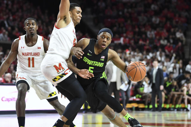 Michigan State guard Cassius Winston (5) handles the ball against Maryland forward Ricky Lindo Jr. (4). (AP Photo/Terrance Williams)