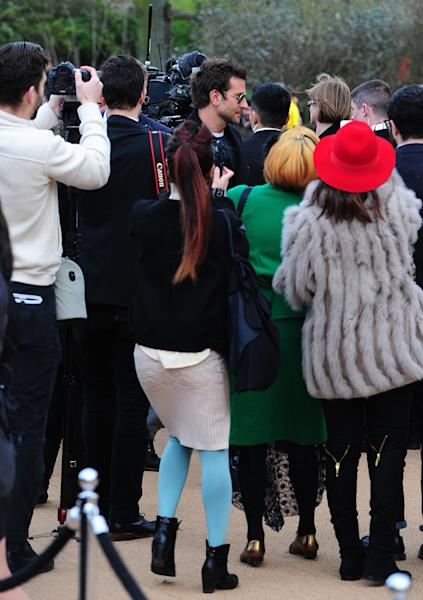 U.S actor Bradley Cooper, center, is photographed arriving for the Burberry Prorsum autumn/winter 2014 London Fashion Week show at Kensington Gardens, London, Monday, Feb. 17, 2014. (AP Photo/Ian West, PA Wire) UNITED KINGDOM OUT - NO SALES - NO ARCHIVES