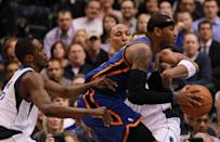Carmelo Anthony (middle) dribbles the ball against Shawn Marion and Rodrigue Beaubois (left) of the Dallas Mavericks at American Airlines Center on March 6, 2012 in Dallas. (Photo by Ronald Martinez/Getty Images)