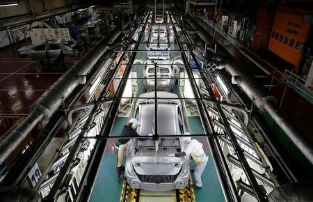 Employees work on an assembly line of the Toyota Motor Corp's Prius hybrid car at the Tsutsumi plant in Toyota, central Japan, December 8, 2017.  REUTERS/Toru Hanai