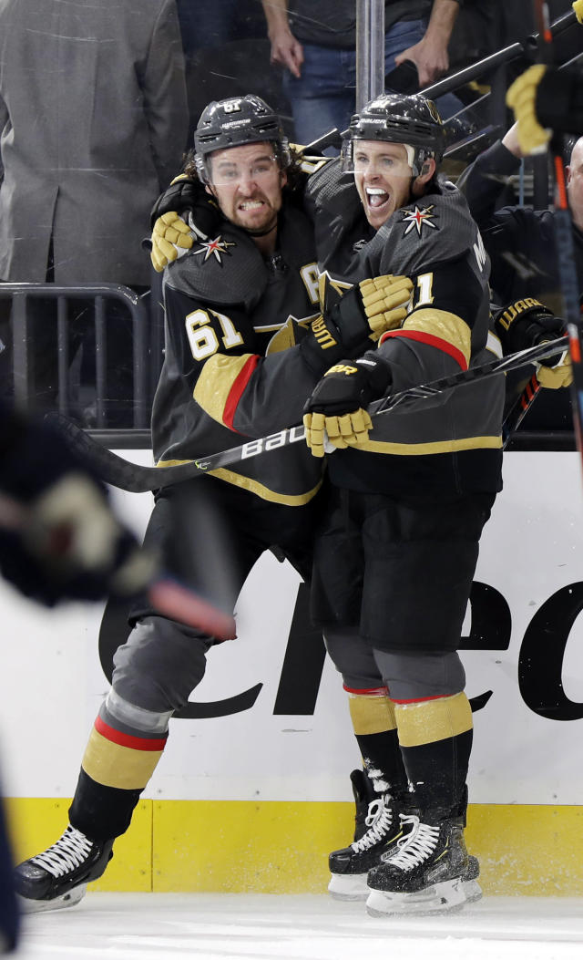 Vegas Golden Knights center Jonathan Marchessault, right, celebrates with right wing Mark Stone after scoring a power-play goal against the St. Louis Blues in overtime of an NHL hockey game Thursday, Feb. 13, 2020, in Las Vegas. The Golden Knights won 6-5. (AP Photo/Isaac Brekken)