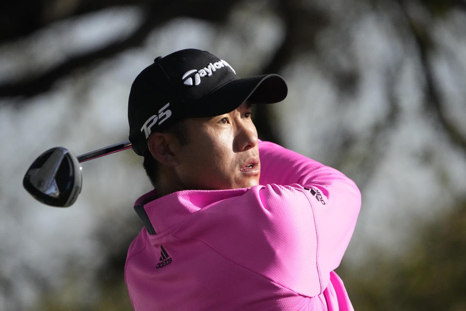 Collin Morikawa watches his tee shot on the 10th hole during a practice round for the Dell Technologies Match Play Championship golf tournament Tuesday, March 23, 2021, in Austin, Texas. (AP Photo/David J. Phillip)